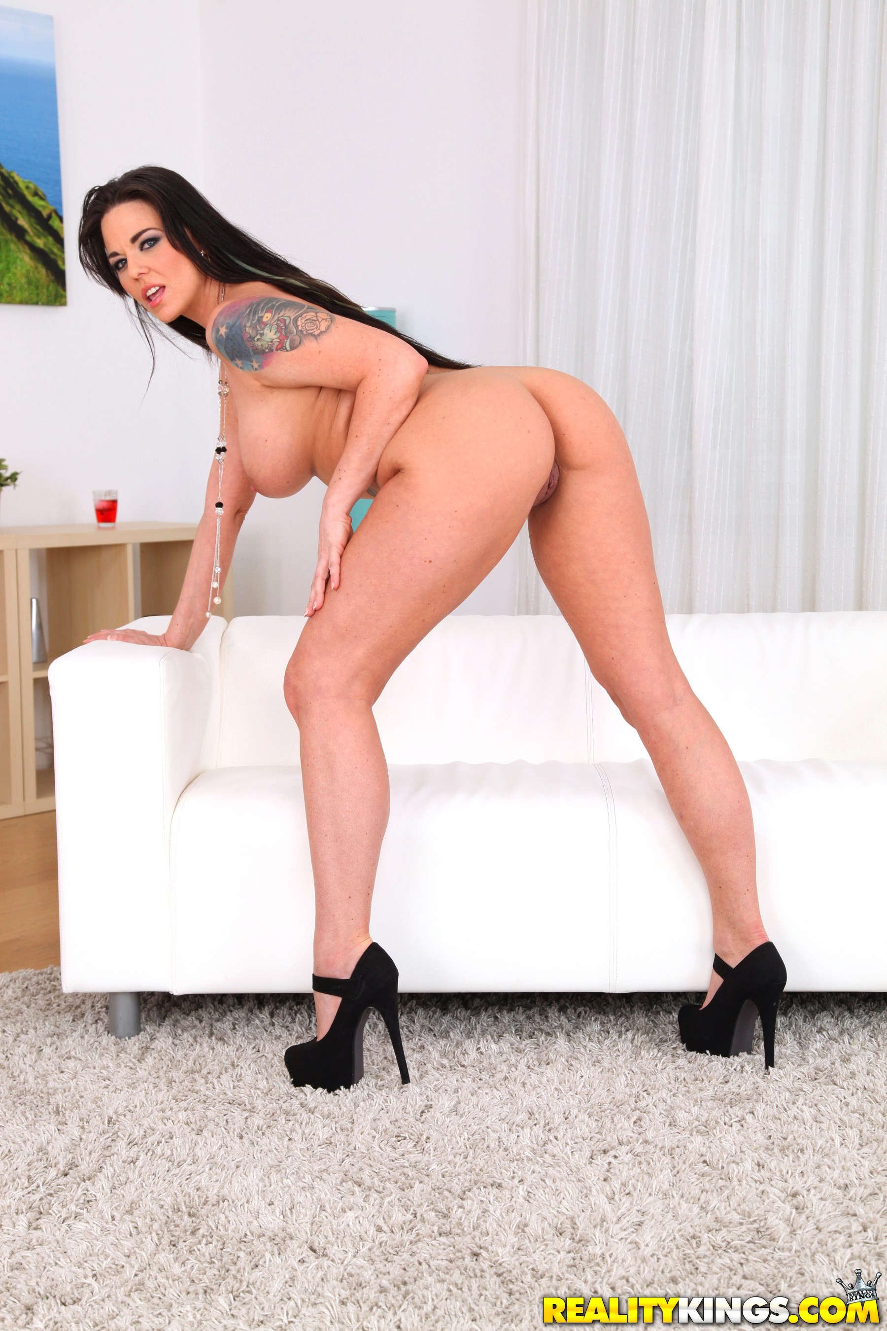 Ass, Big Tits, Brunette, Couch, Heels, Ivory, Long Hair, MILF, Solo, Tattoo picture